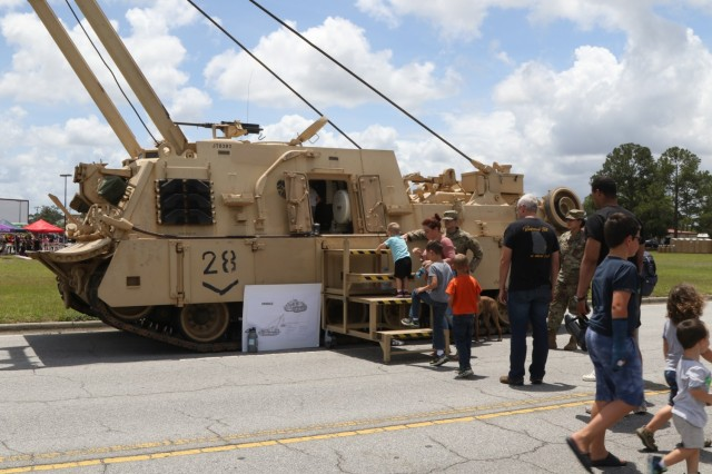 Military Families go inside and experience first-hand an M88A2 provided by 3rd Battalion, 67th Armor Regiment, 2nd Armored Brigade Combat Team, on Fort Stewart, Georgia, May 19, 2021, as a part of the Family day Marne Week celebration. Marne Week brings together currently serving Dogface Soldiers, Veterans, Family Members, and the community to celebrate the Division's legacy. (U.S. Army photo by Sgt. Javiera F. Scott)