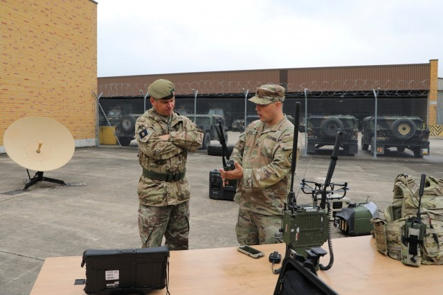 Brigadier Sam Humphris (left), commander of the 1st Armoured Infantry Brigade (UK), and Staff Sgt. John Mock, 3rd Squadron, 2nd Cavalry Regiment, discuss the Integrated Tactical Network's performance during Saber Junction 21. The 1st Armoured Infantry Brigade visited the 2d Cavalry Regiment at Rose Barracks, Germany to discuss capabilities and future training opportunities between the two units on Oct. 5, 2021.