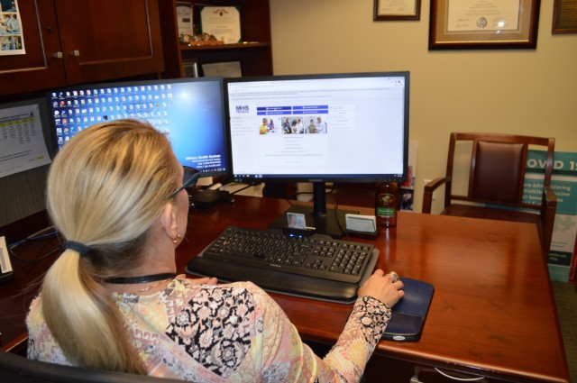 Elaine Sanchez explores the new MHS GENESIS Patient Portal at Brooke Army Medical Center, Joint Base San Antonio-Fort Sam Houston, Texas, Oct. 6, 2021. The San Antonio Market will transition to the new electronic health record system – known as MHS GENESIS – in January 2022. (U.S. Army Photo by Lori Newman)