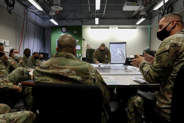 U.S. Army Soldiers from warfighting functions throughout the 3rd Infantry Division participate in a targeting working group during Warfighter 22-1 in the Mission Training Center on Fort Stewart, Georgia, Oct. 4, 2021. As a subordinate unit to the Army's V Corps headquarters in the exercise, the event stressed the integration and reporting of all 3rd ID warfighting functions in a simulation designed to generate tough decisions and catastrophic consequences against a live, free-thinking adversary, from Sept. 27 to Oct. 6.