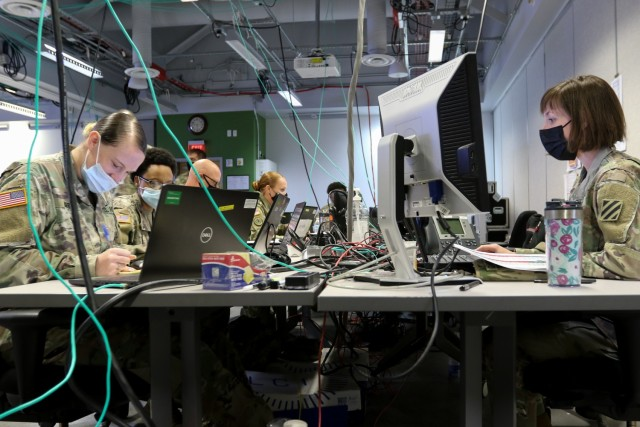 U.S. Army human resources and medical specialists and officers assigned to Headquarters and Headquarters Battalion, 3rd Infantry Division, participate in Warfighter 22-1 in the reserve command post on Fort Stewart, Georgia, Oct. 4, 2021. The WFX occurred across an extensive network of computers in a simulation integrated around the world, for V Corps and U.S. Army Europe and Africa across the Atlantic Ocean, and their supporting units in multiple states across the U.S. For the 3rd ID and its subordinate staffs and commands, the event played out at the Mission Command Training site near Fort Stewart.
