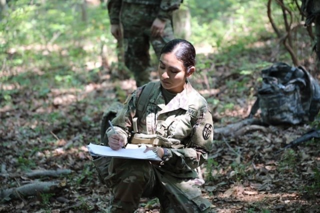 During a training event, Cadet Lissette Sandoval demonstrates how to communicate through radio etiquette before sending up a SALUTE report to headquarters. | Photo provided by Lissette Sandoval.