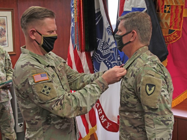 Maj. James Kitchen (right), Command Judge Advocate Army Materiel Command Legal Center - Detroit Arsenal, receives the Meritorious Service Medal from Maj. Gen. Darren Werner, commanding general U.S. Army Tank-automotive and Armaments Command, during his retirement ceremony on Sept. 14.