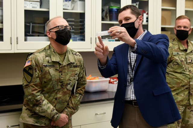 Brig. Gen. Anthony McQueen (left), commanding general of USAMRDC and Fort Detrick, Maryland, visits the USAMRDC's U.S. Army Institute of Surgical Research in San Antonio, Texas.
