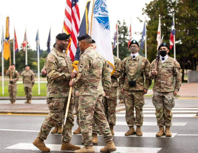 Gen. Michael X. Garrett, commander of U.S. Army Forces Command, passes the I Corps colors to Lt. Gen. Xavier T. Brunson during an assumption of command ceremony at Joint Base Lewis-McChord, Wash., Oct. 6, 2021. Following a promotion, Brunson assumed command of America's First Corps and JBLM.