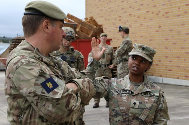 Brigadier Sam Humphris (left), commander of the 1st Armoured Infantry Brigade (UK), and Spc. Asia Wilson, 3rd Squadron, 2d Cavalry Regiment, discuss the Integrated Tactical Network's performance during Saber Junction 21. The 1st Armoured Infantry Brigade visited the 2nd Cavalry Regiment at Rose Barracks, Germany, to discuss capabilities and future training opportunities between the two units Oct. 5, 2021.