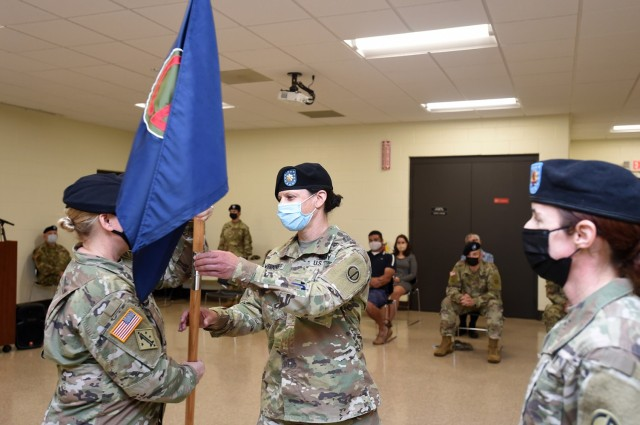 Maj Jody Wernikoff, right, incoming headquarters and headquarters company commander, receives the colors from Col. Stacy Cordell, Deputy Commanding Officer, 85th U.S. Army Reserve Support Command. Wernikoff assumed command of the 85th USARSC HHC, October 3, 2021.  (U.S. Army Reserve photo by Capt. Michael Ariola)