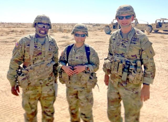 Maj. Davarius Sharpe, Capt. Maddison Wild, and Maj. Gen. Dennis P. LeMaster at the National Training Center, Fort Irwin, California.