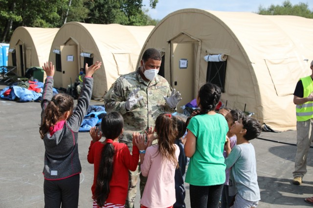 Soldiers from 21st Theater Sustainment Command provide security and assistance to Afghan evacuees at the transit area known as pod 51 on Ramstein Air Base September 9, 2021. The transit center provides a safe place for the evacuees to complete their paperwork while security screenings and background checks are conducted before they continue on to their final destination.