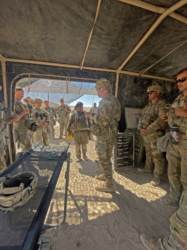 Maj. Gen. Dennis P. LeMaster receiving a briefing while at the National Training Center, Fort Irwin, California.