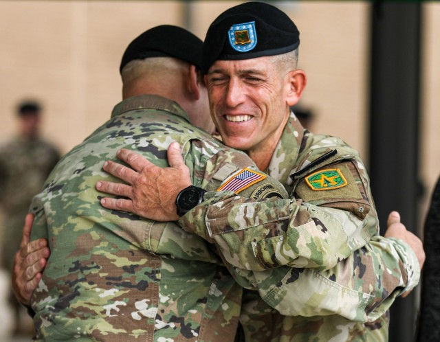 Command Sgt. Maj. William Shoaf, the outgoing senior enlisted leader for 716th Military Police Battalion, 16th Military Police Brigade, embraces a fellow Soldier during his change of responsibility ceremony at Fort Campbell, Ky., Sept. 1, 2021. Shoaf won the senior noncommissioned officer category for the Sgt. Maj. Larry L. Strickland Educational Leadership Award for his work at the unit during the Sergeant Major of the Army Forum and Awards Ceremony in Washington, D.C., Oct. 11, 2021.