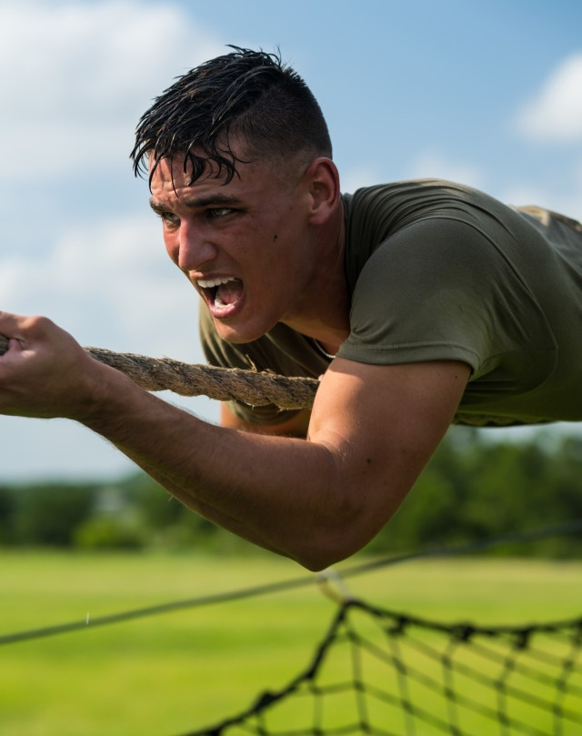 Spc. Justin Earnhart makes his way down the inverted rope descent obstacle during the Army Futures Command's Best Warrior Competition at Joint Base San Antonio-Fort Sam Houston, Texas, June 8, 2021. Earnhart won the Army's Soldier of the Year award during a ceremony at the Association of the U.S. Army Annual Meeting and Exposition in Washington, D.C., Oct. 11, 2021.
