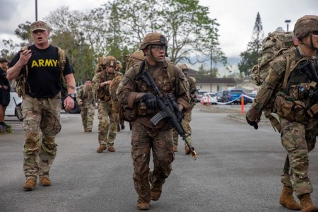 Soldiers assigned to the 25th Infantry Division and U.S. Army Hawaii complete a 12-mile ruck march before testing on the final lane for the Expert Infantryman Badge and Expert Soldier Badge at Schofield Barracks, Hawaii, April 30, 2021.  Soldiers may soon have the opportunity to earn an expert badge up to three times a year.