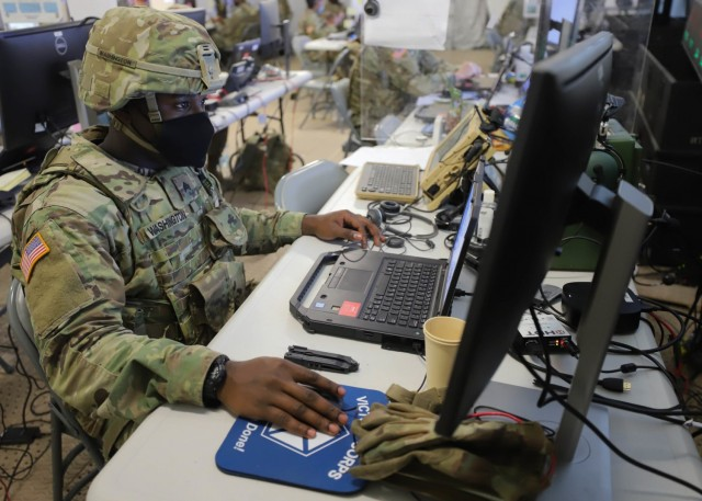 GRAFENWOEHR, Germany – Sgt. Fernando Washington, from Birmingham, Alabama, works at V Corps' main command post during Warfighter 22-1 in Grafenwoehr, Germany, Oct. 4. The WFX 22-1 is V Corps' final certifying exercise in becoming the U.S. Army's fourth corps headquarters and America's forward deployed corps in Europe. (U.S. Army photos by Pfc. Devin Klecan/released)