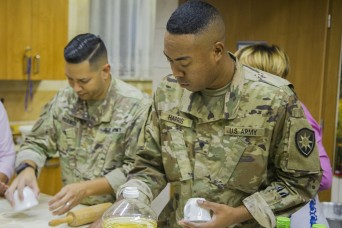 US Soldiers prepare, share meal with Polish locals
