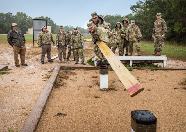 Ryan Spry (in front) and Ben Schreiber, two of the 12 civilians participating in the U.S. Army Corps of Engineers Kansas City District Leader Development Program, attempt to complete one of the obstacles Oct. 6 at the Team Development Course. The goal of the three-day LDP here is to build camaraderie, communication and leadership skills while also learning more about the Army.