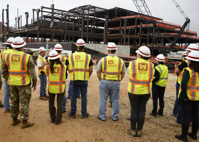 Mark French, the U.S. Army Corps of Engineers' chief of quality assurance for the new hospital construction project here, speaks with the 12 civilians participating in the USACE Kansas City District Leader Development Program Oct. 7 during a tour of the construction project, set for completion in 2024.