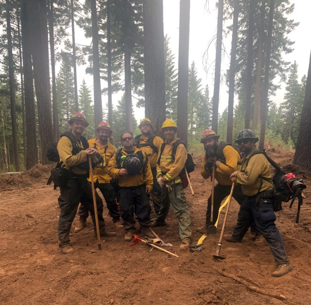 Sierra Army Depot firefighters pause from digging fire break lines to pose for a photo while providing support to local efforts to combat the Dixie Fire, July 2021, in northern California. The Sierra Army Depot fire department was named as the U.S. Army Materiel Command Fire Department of the Year for 2020, partially due to its support to local authorities in combating wildfires during the 2020 wildfire season.