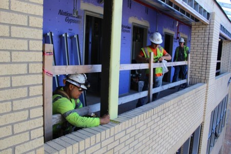 Gary Garcilazo and Joachin Ayala take measurements for the installation of a curtain wall system at a barracks under renovation at Fort Hood, Texas. This particular barracks, in the 14000 block of the installation, is expected to be completed in the Spring of 2022.
