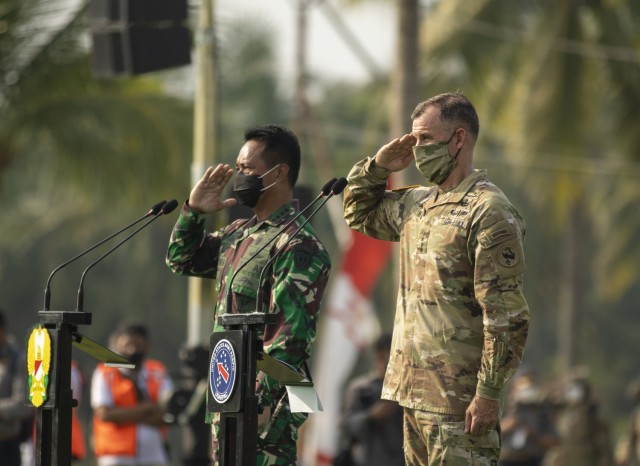 U.S. Army Gen. Charles Flynn, commanding general of U.S. Army Pacific, and Gen. Andika Perkasa, Chief of Staff of the Indonesian Army, return a salute to troops in formation during the opening ceremony for Garuda Shield 21 at the Baturaja Training Area, on August 4, 2021. Garuda Shield 21 is a two-week joint-exercise between the United States Army and Tentara Nasional Indonesia (TNI-AD Indonesia Armed Forces). The purpose of this joint-exercise is to enhance and enrich the jungle warfare ability of both the U.S. Army and Indonesian Army. (U.S. Army photo by Staff Sgt. Thomas Calvert)