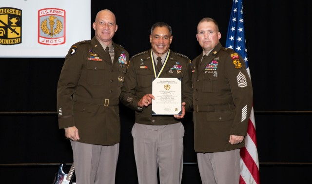 Gen. Michael Garrett, an Army ROTC alumnus of Xavier University, is awarded for his years of service to Army ROTC at the 2021 AUSA Conference in Washington, Oct. 11, 2021. Garrett was honored as a 2021 Army ROTC Hall of Fame inductee.   Photo by Kyle Crawford, USACC Public Affairs