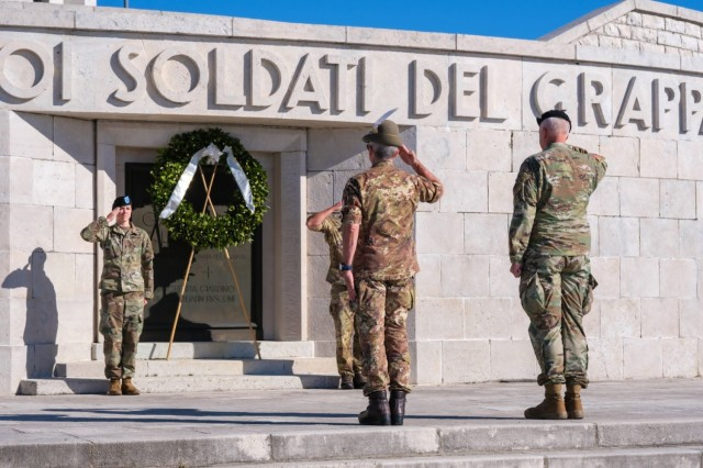 Col. Scott P. Noon, US Army Southern European Task Force, Africa G4 logistics director, right, and Col. Michele Biasiutti, US Army Garrison Italy Italian senior officer, second from right, salute during a wreath laying ceremony at the Monte Grappa military memorial in Crespano del Grappa, Italy on September 25, 2021. SETAF-AF G4 conducted a staff walk focusing on the Italian military campaign in WWI global;  the event ended with a trek on Monte Grappa, where the Italian army fought three decisive battles against German and Austro-Hungarian forces in 1917-18.